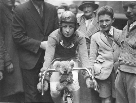Close-up of Billie Samuel on the Malvern Star bike showing her koala bear mascot before leaving for Melbourne, 4 July 1934, by Sam Hood